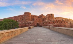 Agra Fort red sandstone medieval fort in panoramic view at sunrise. Agra Fort is a UNESCO World Heritage site in the city of Agra India.