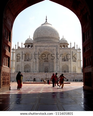 AGRA, INDIA - JANUARY 21: Indian tourists walk Towards the Taj Mahal on January 21,2012 in Agra, India. It is an UNESCO World Heritage site and is an example of Mughal architecture.