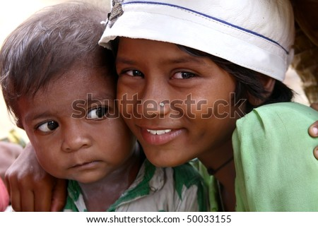 AGRA, INDIA - JUNE 19: Portrait of tribal familly in a village in india, from Agra June 19, 2008 in Agra, India.