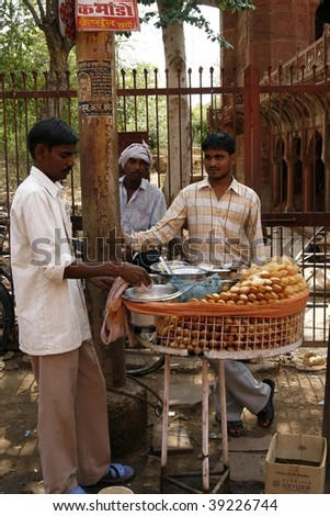 AGRA, INDIA - JUNE 17: Street vendors sell food June 17, 2007 in Agra, India. Most common health risks in India are hep B and typhoid, main source of contamination is unclean food.