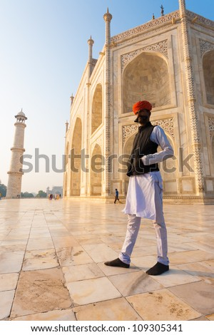 AGRA, INDIA - NOVEMBER 19, : An unidentified Indian man stands atop the base of the Taj Mahal, open free to the public one day on Indian Heritage Day on November 19, 2009 in Agra, India