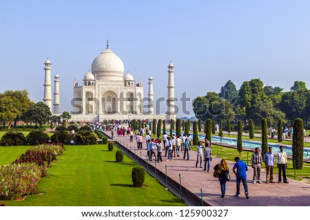 AGRA, INDIA - OCT 18: The people visit Taj Mahal, Agra, India on Oct 18, 2012. The Taj Mahal is a mausoleum located in Agra, India and is one of the most recognizable structures in the world