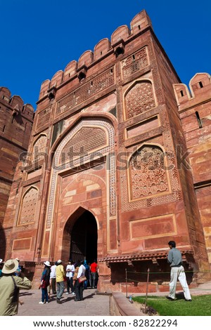 AGRA, UTTAR PRADESH, INDIA - MARCH 26: A crowd of tourists visit Agra Fort on March 26, 2011 in Agra, Uttar Pradesh, India. The fort is the old Mughal Empire capital and a UNESCO World Heritage Site.