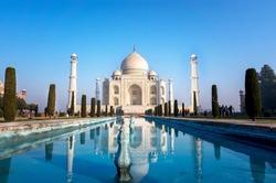 Agra, Uttar Pradesh, India - The morning view of Taj Mahal monument reflecting in water of the pool, Agra, India