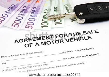 agreement document contract for sale of a motor vehicle with car key and money - stock photo