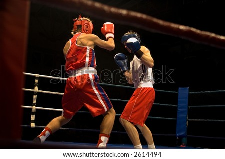 Agressive boxing fight, two boxers fighting on the ring