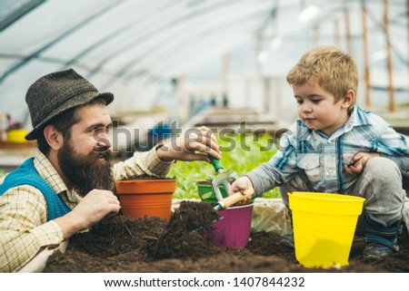 agricultural activity. agricultural activity of father and son in greenhouse. agricultural activity and environmental ecology concept. agricultural activity of happy family. sharing good time #1407844232