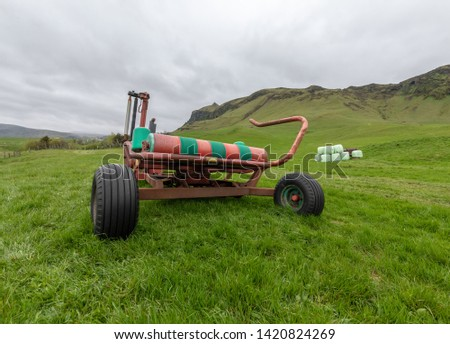 Agricultural bale wrapping equipment, used with tractor to wrap bales of hay in plastic #1420824269