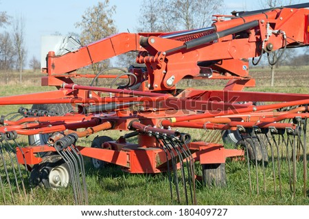 agricultural equipment on a field / agricultural equipment #180409727