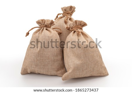 Agricultural hessian cloth sacks, rough sack material and linen fabric textile concept with pile of three brown burlap or sackcloth bags isolated on white background with clipping path cutout Stock photo ©