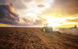 Agricultural industry tractors machinery tools plow large areas soil preparation and reducing labor costs.Agricultural analyst plan production food processing meet increasing consumption concept