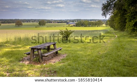 Agricultural landscape with picknick table seen from Bergherbos nature reserve Stockfoto ©