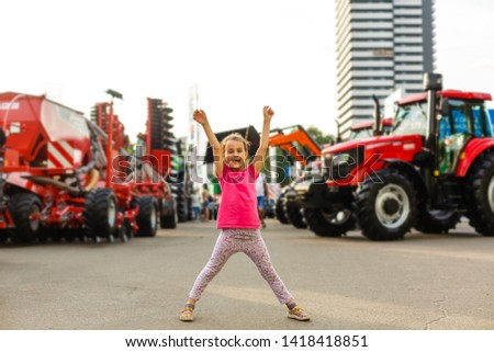 Agricultural machinery in agricultural fair child, girl, little