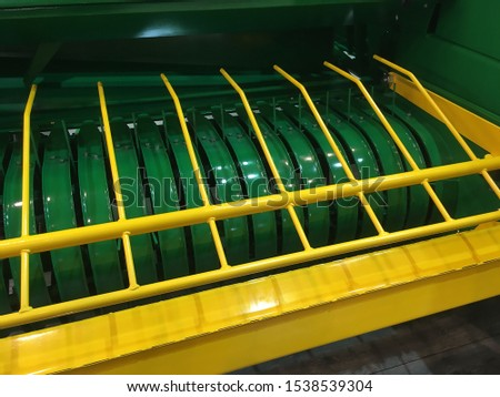 Agricultural machinery. Press the pick-up for selection of rolls of hay, straw pressed in bales.