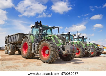 Agricultural machinery. Tractor, standing in a row