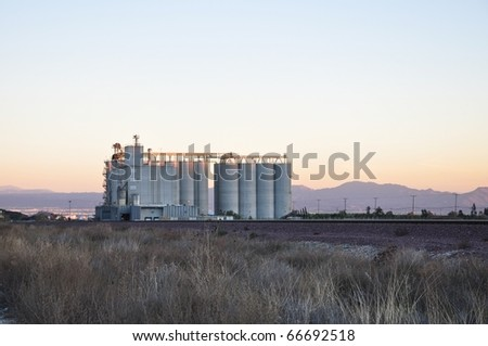 Agricultural mill evening sky