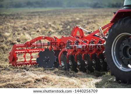 Agricultural plow close-up on the ground, agricultural machinery. Stockfoto ©