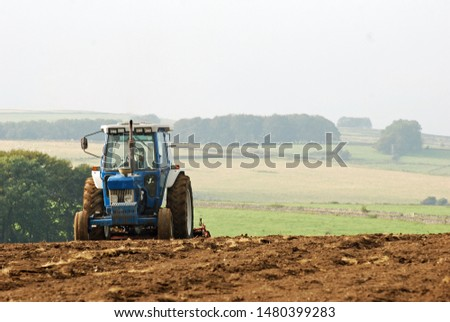 Agricultural Tractor plugging fields ready to sow crops