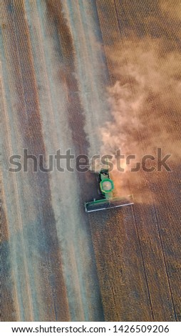 Agriculture crop farming in South Australia, Drone shots of A combine harvester harvesting wheat and barley from a farmers field. #1426509206