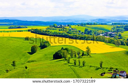 Agriculture farm field top view landscape. Mountain valley agriculture fields landscape. Agriculture fields view