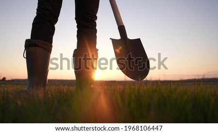 agriculture. farmer with a shovel walk in the field. agriculture business harvesting of a farmer man with shovel a walk to work in the field. business soil sun natural roducts harvest Stock photo ©