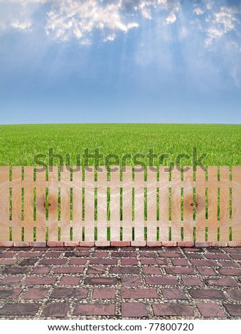 Agriculture garden with wooden fence, stone square paving by granite, paddy field with produce grains and rays from heaven - stock photo