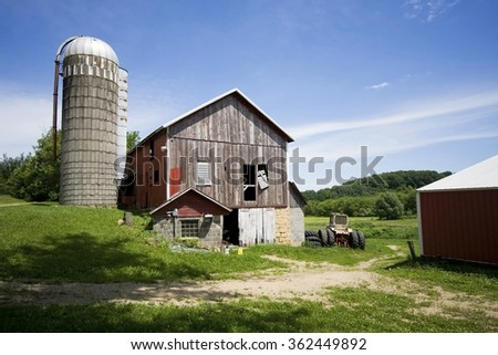 Agriculture, industry and farming background. Summer rural landscape with old abandoned farm buildings. Travel America background, Wisconsin, Midwest USA.