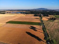 Agriculture landscape in Poland. Harvest time fields view in Lower Silesia (Dolnoslaskie) province. Sleza mountain in background.