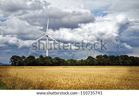 Agriculture landscape with wind turbines. Europe
