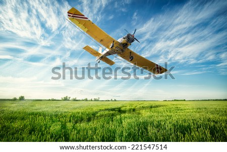 Shutterstock Agriculture, low flying yellow plane sprayed crops in the field
