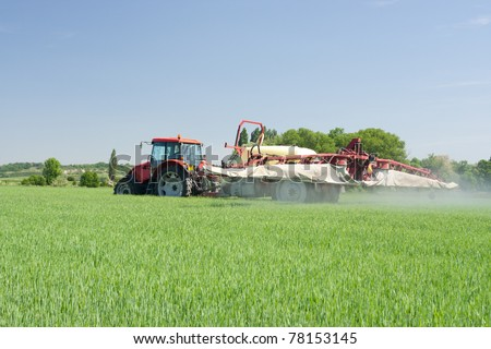 Agriculture - tractor dusting chemical manure (plant protection with pesticides)