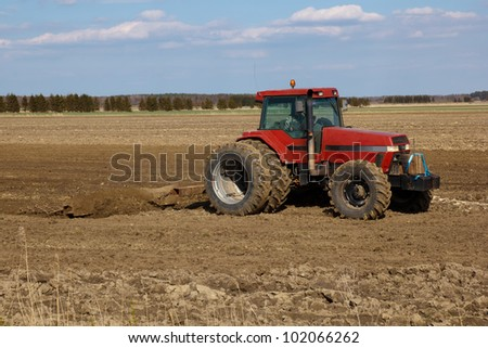 Agriculture.  tractor plowing the fields