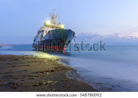 Aground scientific ship is waiting for rescue, Sakhalin island, Russia