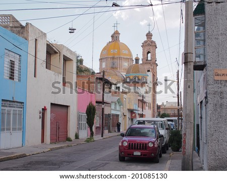 AGUASCALIENTES, MEXICO - OCTOBER 7,  2013:  Cityscape with old cathedral in downtown  Aguascalientes city, Aguascalientes State, North central Mexico.