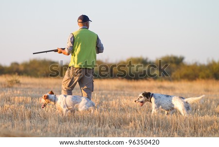 Agustin Romain (pointer and english setter trainer) trains a pointer with quails and shotgun for hunting