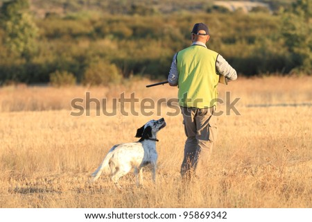 Agustin Romain (pointer and english setter trainer) trains a pointer with quails for hunting