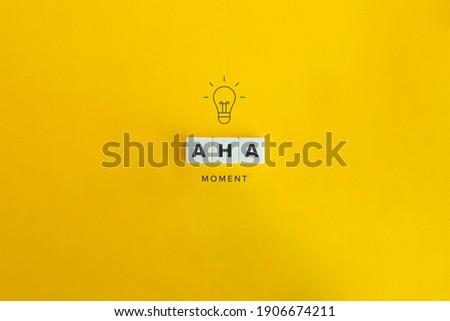Aha Moment, Problem Solving, and Eureka Effect Concept Banner. Block letters on bright orange background. Minimal aesthetics. Сток-фото ©