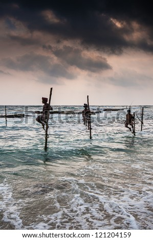 AHANGAMA, SRI LANKA-OCTOBER 23: The local fishermen are fishing in unique style. The standing on the single timber pole can only found in this Indian ocean on October 23, 2009 in Ahangama, Sri Lanka.