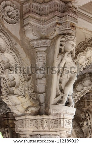 AHMEDABAD, GUJARAT, INDIA - AUGUST 21 : Hutheesing Jain Temple on August 21, 2012 in Ahmedabad. Sculpture of a dancing girl  ( Apsara ) on an ornated column decorated with beautiful stone carved arch.