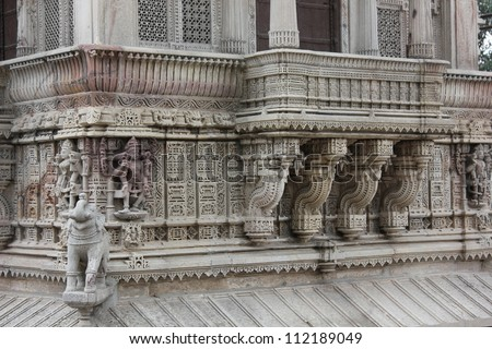 AHMEDABAD, GUJARAT, INDIA - AUGUST 21 : Hutheesing Jain Temple on August 21, 2012 in Ahmedabad. Wonderful stone carving on the veranda of first floor. A heritage architectural design built in 1847 AD.