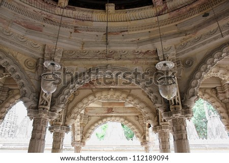 AHMEDABAD, GUJARAT, INDIA - AUGUST 21 : Hutheesing Jain Temple on August 21, 2012 in Ahmedabad. Ornamental stone carving on arches, columns & ceiling of 'Rangamandapa' hall for musical performances.