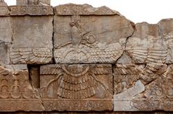 Ahura Mazda - persian bas-relief in Persepolis, Iran. Ancient Persian art, sculpture in Iran. Zoroastrian persian art.