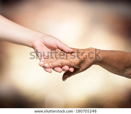 aid concept - problems elderly - hands of young and senior  #180705248