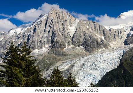 Aiguille du Midi (3842 m) and Glacier de Bossons in Mont Blanc massif. Chamonix, France.