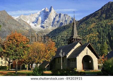 Aiguille Verte and Les Drus view near the chapel of the mountain village of Les Praz de Chamonix in the French Alps.
