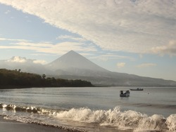 Aimere beach waves, Flores. The background of Mount Inerie in Ngada Regency, Flores, East Nusa Tenggara, Indonesia.