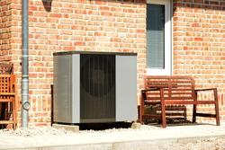 Air-Air Heat Pump for Heating and hot Water in Front of an Apartment Building