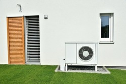 Air-Air Heat Pump for Heating and hot Water in Front of an new built Residential Building