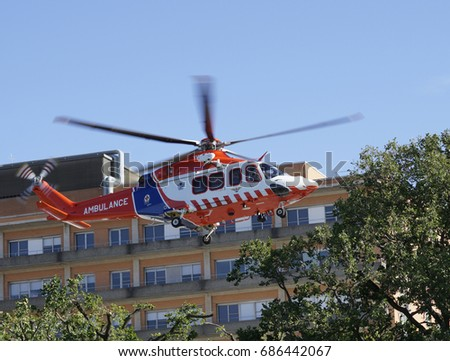 Air ambulance takes off from hospital roof.