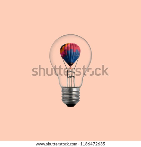 Air Ballon in Lightbulb on color background.